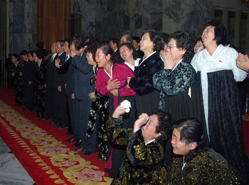 North Koreans cry as they pay respects to their late leader Kim Jong Il. (AP Photo/Korean Central News Agency via Korea News Service)