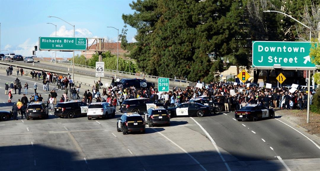 Demonstrators protesting this week's fatal shooting of an unarmed black man shut down Interstate 5 in Sacramento, Calif. Hundreds of people rallied for Stephon Clark, a 22-year-old who was shot Sunday in his grandparents' backyard.(AP Photo/Robert Peters)