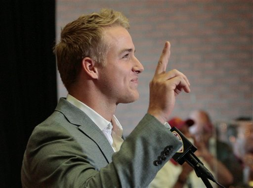 Southern California quarterback Matt Barkley announces that he is forgoing the opportunity to make himself available for the NFL football draft and will play his senior year during a news conference at the university in L.A., Thursday, Dec. 22, 2011.