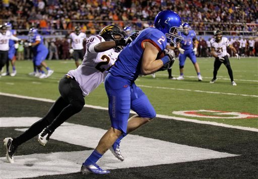 Boise State wide receiver Matt Miller (2) catches a pass for a touchdown against Arizona State cornerback Osahon Irabor (24) during the second quarter of the Maaco Bowl NCAA college football game Dec. 22, 2011, in Las Vegas. (AP Photo/Julie Jacobson),