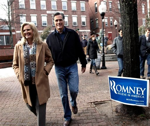 Republican presidential candidate, former Mass. Gov. Mitt Romney and his wife Ann walk through a square while campaigning in Concord, N.H. Friday, Dec. 23, 2011. (AP Photo/Winslow Townson)