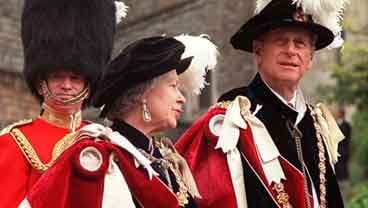 Britain's Queen Elizabeth II and her husband Prince Philip lead the annual procession of members of the Order of the Garter from Windsor Castle to St. George's Chapel in Windsor, England in this June 15, 1998 file photo. (AP Photo / Alastair Grant, File)