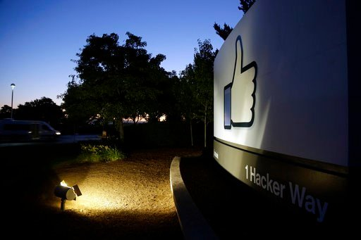"""File - In this Jun 7, 2013, file photo, the Facebook """"like"""" symbol is illuminated on a sign outside the company's headquarters in Menlo Park, Calif. (AP Photo/Marcio Jose Sanchez, File)"""