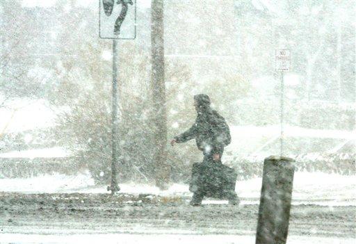 A person walks along North Mesa during a snow storm in West El Paso, Texas, Friday, Dec. 23, 2011. (AP Photo/El Paso Times, Rudy Gutierrez)