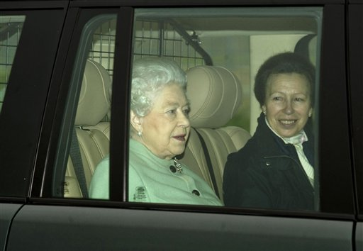 Britain's Queen Elizabeth II, left, and Princess Anne arrive at Papworth Hospital to visit Prince Philip, in Cambridge, England, Saturday, Dec. 24, 2011. (AP Photo/PA)