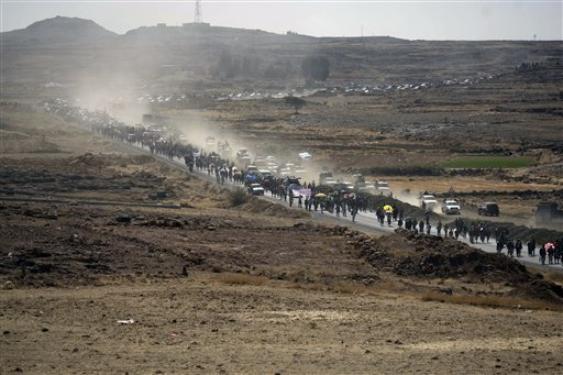 Protesters march during a four-day march from Taiz to Sanaa demanding the prosecution of Yemen's President Ali Abdullah Saleh in Dhamar, Yemen, Friday, Dec. 23, 2011.(AP Photo/Hani Mohammed)