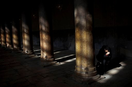 A Christian pilgrim prays inside the Church of Nativity, believed by many to be the birthplace of Jesus Christ, in the West Bank town of Bethlehem, Saturday, Dec. 24, 2011. (AP Photo/Bernat Armangue)