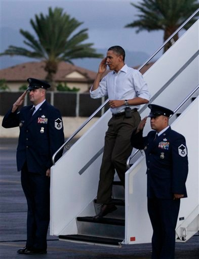 President Barack Obama salutes as he steps off of Air Force One at Hickam Air Force Base in Friday, Dec. 23, 2011, in Honolulu. (AP Photo/Carolyn Kaster)