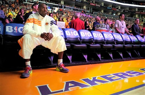 Los Angeles Lakers guard Kobe Bryant waits to be introduced prior to their NBA basketball game against the Chicago Bulls, Sunday, Dec. 25, 2011, in Los Angeles. (AP Photo/Mark J. Terrill)