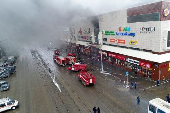 In this Russian Emergency Situations Ministry photo on Sunday, March 25, 2018, smoke rises above a multi-story shopping center in the Siberian city of Kemerovo.