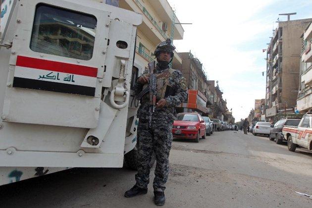 An Iraqi policeman, seen here during a patrol in Baghdad, on December 13. (AFP Photo/Ahmad al-Rubaye)