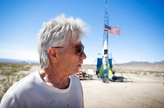 "In this March 6, 2018, file photo, ""Mad"" Mike Hughes reacts after the decision to scrub another launch attempt of his rocket near Amboy, Calif."