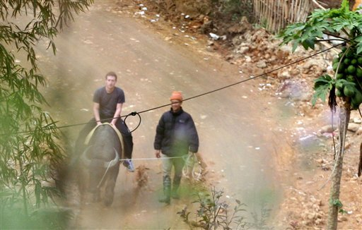 In this Dec. 26, 2011 photo, Facebook website founder Mark Zuckerberg rides a water buffalo in northern resort town of Sapa in Lao Cai province, Vietnam in this picture taken. (AP)