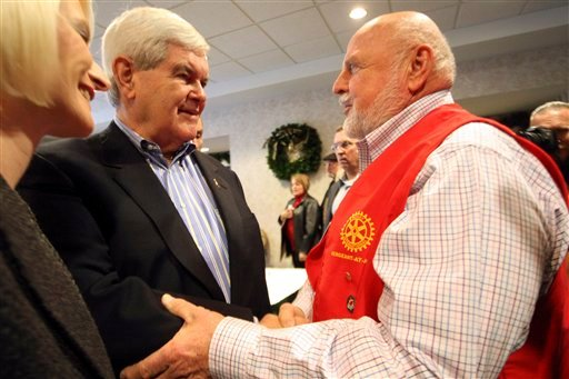 Republican presidential candidate, former House Speaker Newt Gingrich and his wife Callista speak with Wally Brown, of Dubuque, Iowa, during a campaign stop at the Dubuque Rotary Club Tuesday, Dec. 27, 2011. (AP Photo/The Telegraph Herald, Jessica Reilly)