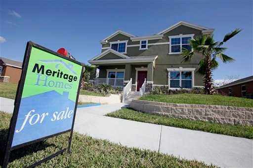 This Dec. 20, 2011 photo, shows a new home for sale in Winter Garden, Fla. U.S. home prices fell in most major cities for the second straight month, further evidence that the housing recovery will be bumpy. (AP Photo/John Raoux)