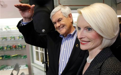 Republican presidential candidate, former House Speaker Newt Gingrich, is accompanied by his wife Callista during a campaign stop at the National Farm Toy Museum in Dyersville, Iowa, Tuesday, Dec. 27, 2011. (AP Photo/Charles Dharapak)