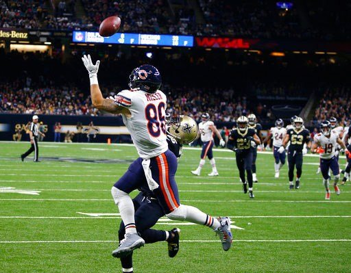 Chicago Bears tight end Zach Miller (86) pulls in a touchdown reception, that was ruled incomplete upon review, as New Orleans Saints defensive back Rafael Bush (25) covers, in the second half of an NFL football game in New Orleans, Sunday, Oct. 29, 2017.