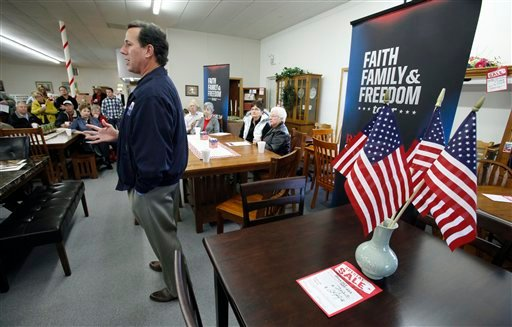 Republican presidential candidate former Pennsylvania Sen. Rick Santorum speaks to local residents during a campaign stop at USA Furniture and Bedding, Wednesday, Dec. 28, 2011, in Dubuque, Iowa. (AP Photo/Charlie Neibergall)