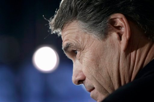 Republican presidential candidate, Texas Gov. Rick Perry speaks during a campaign stop at the Blue Strawberry Coffee Company, Thursday, Dec. 29, 2011, in Cedar Rapids, Iowa. (AP Photo/Charlie Neibergall)