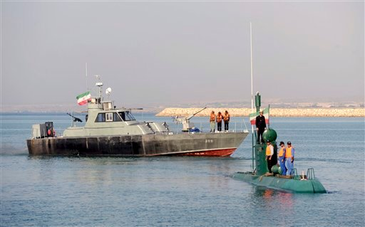 In this photo released by China's Xinhua News Agency, Iranian Navy personnel take part in their naval maneuvers dubbed Velayat 90 on the Sea of Oman, Iran, on Wednesday, Dec. 28, 2011. (AP Photo/Xinhua, Ali Mohammadi)