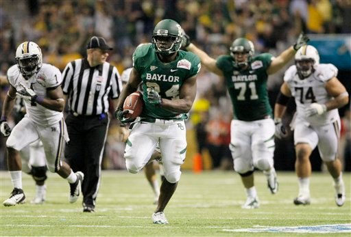 Baylor's Terrance Ganaway, center, rushes for a touchdown during the second half of the Alamo Bowl college football game against Washington, Thursday, Dec. 29, 2011, at the Alamodome in San Antonio.