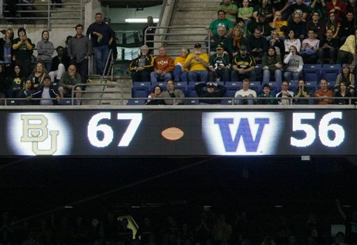 A scoreboard shows what would become the final score, during the second half of the Alamo Bowl college football game between Baylor and Washington.
