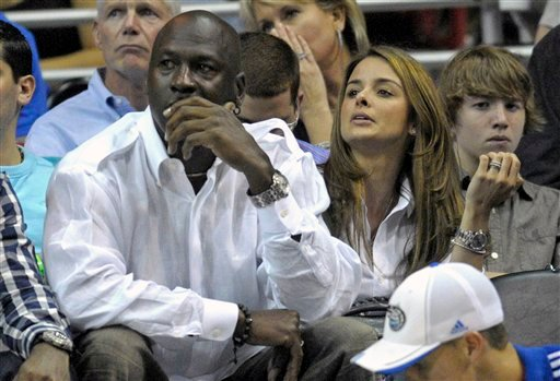 In this April 21, 2010, file photo, Michael Jordan and Yvette Prieto, right, watch the second half of Game 2 of a first round NBA basketball playoff game between the Orlando Magic and the Charlotte Bobcats in Orlando, Fla.
