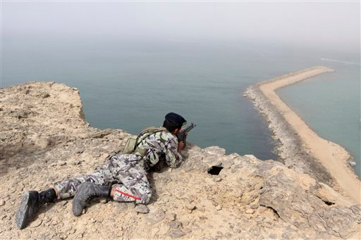 A member of the Iranian military takes position in a drill on the shore of the sea of Oman, on Friday, Dec. 30, 2011. (AP)