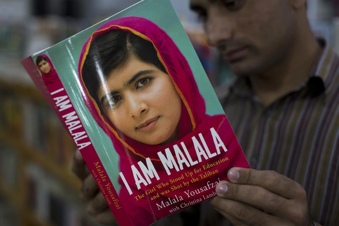 In this Friday, Oct. 10, 2014 file photo, a Pakistani customer reads the book written by Malala Yousafzai, who survived a Taliban attack, in Islamabad, Pakistan.