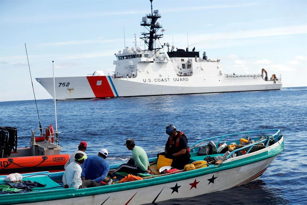 A U.S. Coast Guard law enforcement team from the USCG cutter Stratton boards a fishing boat carrying close to 700 kilos of pure cocaine, in the Pacific hundreds of miles south of the Guatemala-El Salvador border. (AP Photo/Dario Lopez-Mills, File)