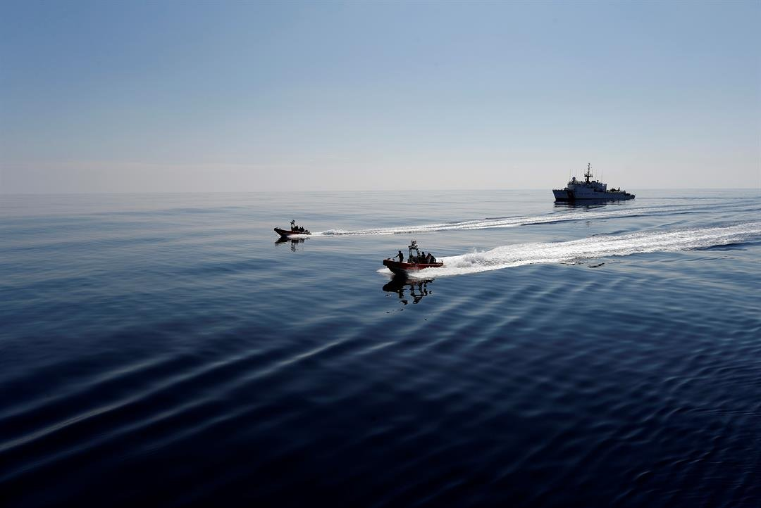U.S. Coast Guard fast boats carrying suspects detained in prior drug interdiction operations are transferred from the USCG cutter Mohawk, seen in the background, to the USCG cutter Stratton, in the eastern Pacific. (AP Photo/Dario Lopez-Mills, File)
