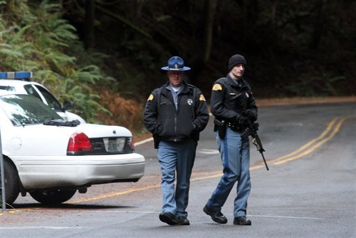 Washington State Patrol troopers with rifles stand at the Paradise entrance to Mount Rainier National Park, Wash., Sunday, Jan. 1, 2012. (AP Photo/The Seattle Times, Greg Gilbert)