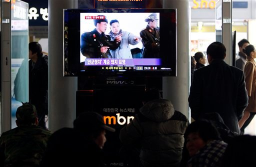 People watch a TV screen reporting about North Korea's next leader Kim Jong Un, at the Seoul Train Station in Seoul, South Korea, Monday, Jan. 2, 2012. (AP)