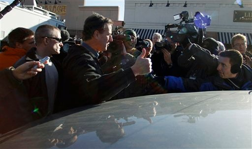 Republican presidential candidate, former Pennsylvania Sen. Rick Santorum gives a thumbs up sign after a campaign stop at the Rising Sun Cafe, Monday, Jan. 2, 2012, in Polk City, Iowa. (AP Photo/Eric Gay)