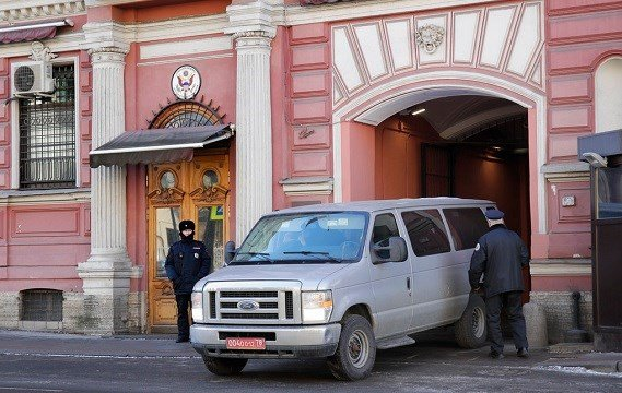 A van leaves the U.S. consulate in St.Petersburg, Russia, Friday, March 30, 2018.