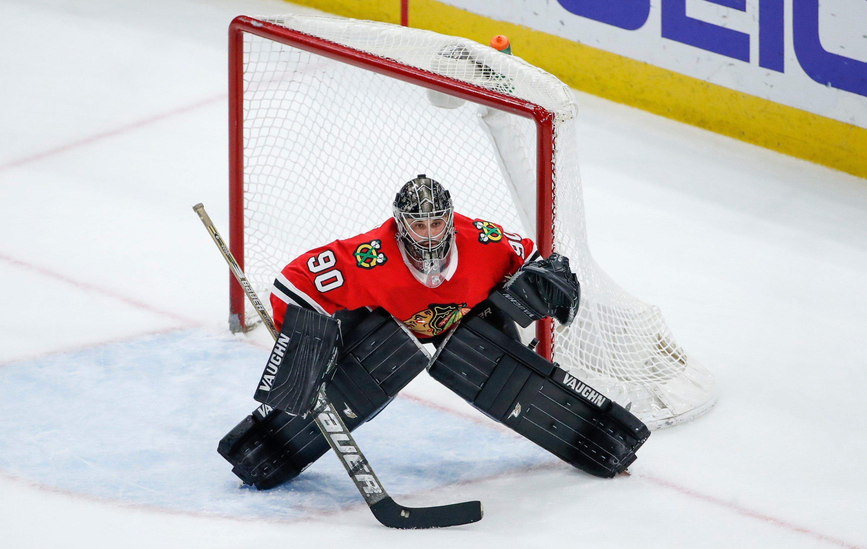 Chicago Blackhawks goalie Scott Foster defends against the Winnipeg Jets during the third period of an NHL hockey game Thursday, March 29, 2018, in Chicago. (AP Photo/Kamil Krzaczynski)