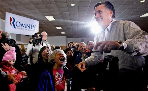 Republican presidential candidate, former Massachusetts Gov. Mitt Romney campaigns at the Mississippi Valley Fairgrounds in Davenport, Iowa, Monday, Jan. 2, 2012. (AP Photo/Charles Dharapak)
