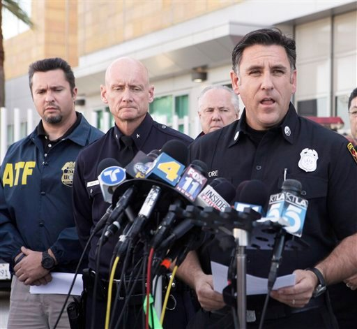 Los Angeles Fire Department Capt. Jaime Moore, right, addresses the media regarding the arrest of a man in connection with dozens of suspected arson attacks that destroyed parked cars, scorched buildings and rattled much of LA. (AP)
