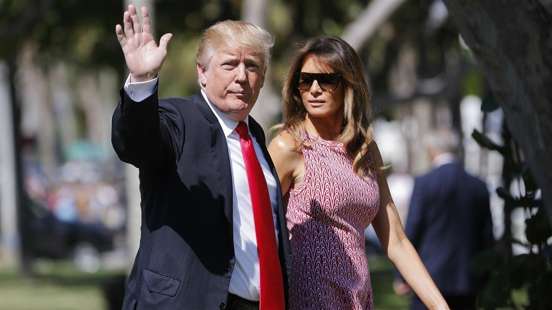 President Donald Trump and first lady Melania Trump arrive for Easter services at Episcopal Church of Bethesda-by-the-Sea, in Palm Beach, Fla., Sunday, April 1, 2018. (AP Photo/Pablo Martinez Monsivais)