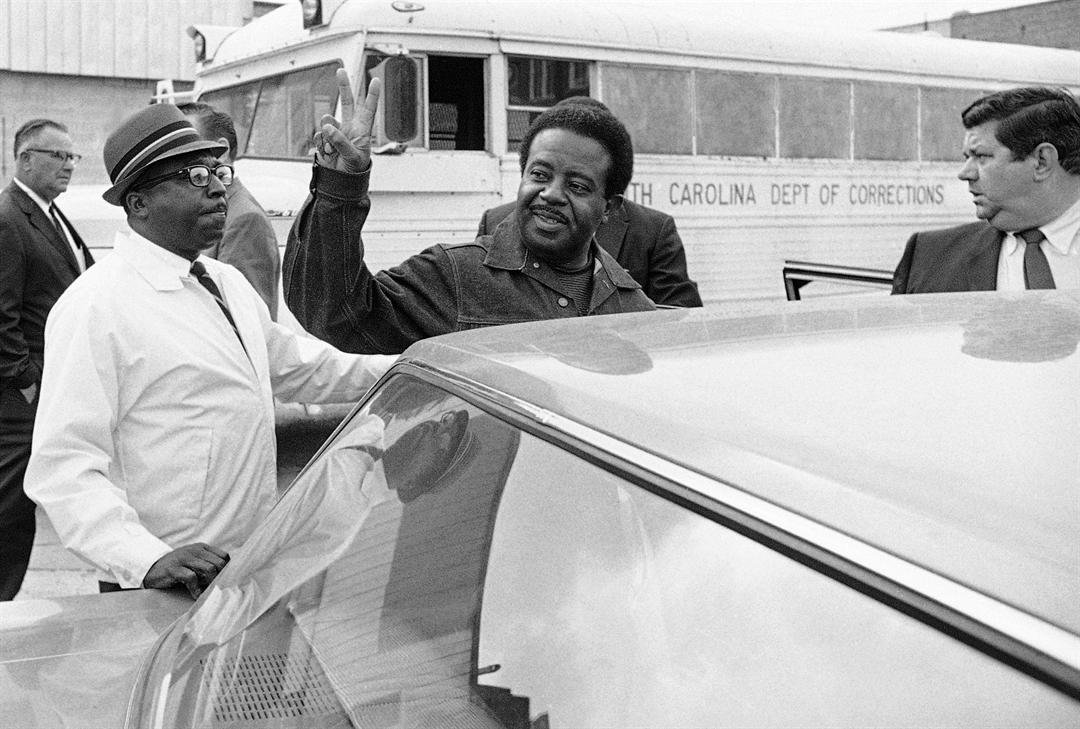 May 2, 1969: Rev. Ralph David Abernathy gives the victory sign as he is escorted back to jail from Charleston County Court, where he and others were taken for hearings on violating an injunction limiting pickets at two hospitals. (AP Photo/Lou Krasky)