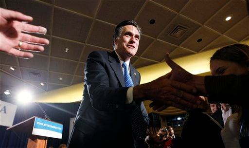 Republican presidential candidate, former Massachusetts Gov. Mitt Romney, greets supporters at his caucus night rally in Des Moines, Iowa, Tuesday, Jan. 3, 2012. (AP Photo/Charles Dharapak)