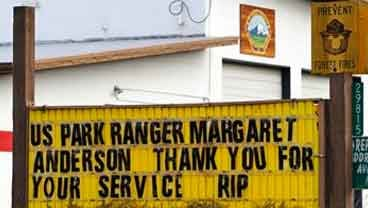 Flags fly at half-staff in honor of Mount Rainer National Park Ranger Margaret Anderson at a fire station Tuesday, Jan. 3, 2012, in Ashford, Wash. (AP Photo/Elaine Thompson)