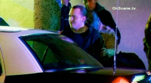 In this image taken from video released on Jan. 2, 2012 by OnScene.tv, arson suspect Harry Burkhart, 24, a German national, is arrested in the Hollywood section of Los Angeles. (AP Photo/OnScene.tv)