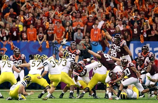 Michigan kicker Brendan Gibbons (34) kicks the game winning field goal in overtime against Virginia Tech in the Sugar Bowl NCAA college football game in New Orleans, Tuesday, Jan. 3, 2012. Michigan won 23-20. (AP Photo/Rusty Costanza, The Times Picayune)
