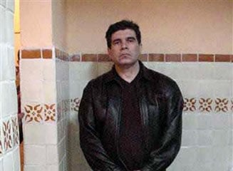 FILE - This March 9, 2002 handout file photo, released by Mexico's Attorney general office, shows Mexican drug lord Benjamin Arellano Felix the day of his arrest inside his house in Puebla, Mexico.