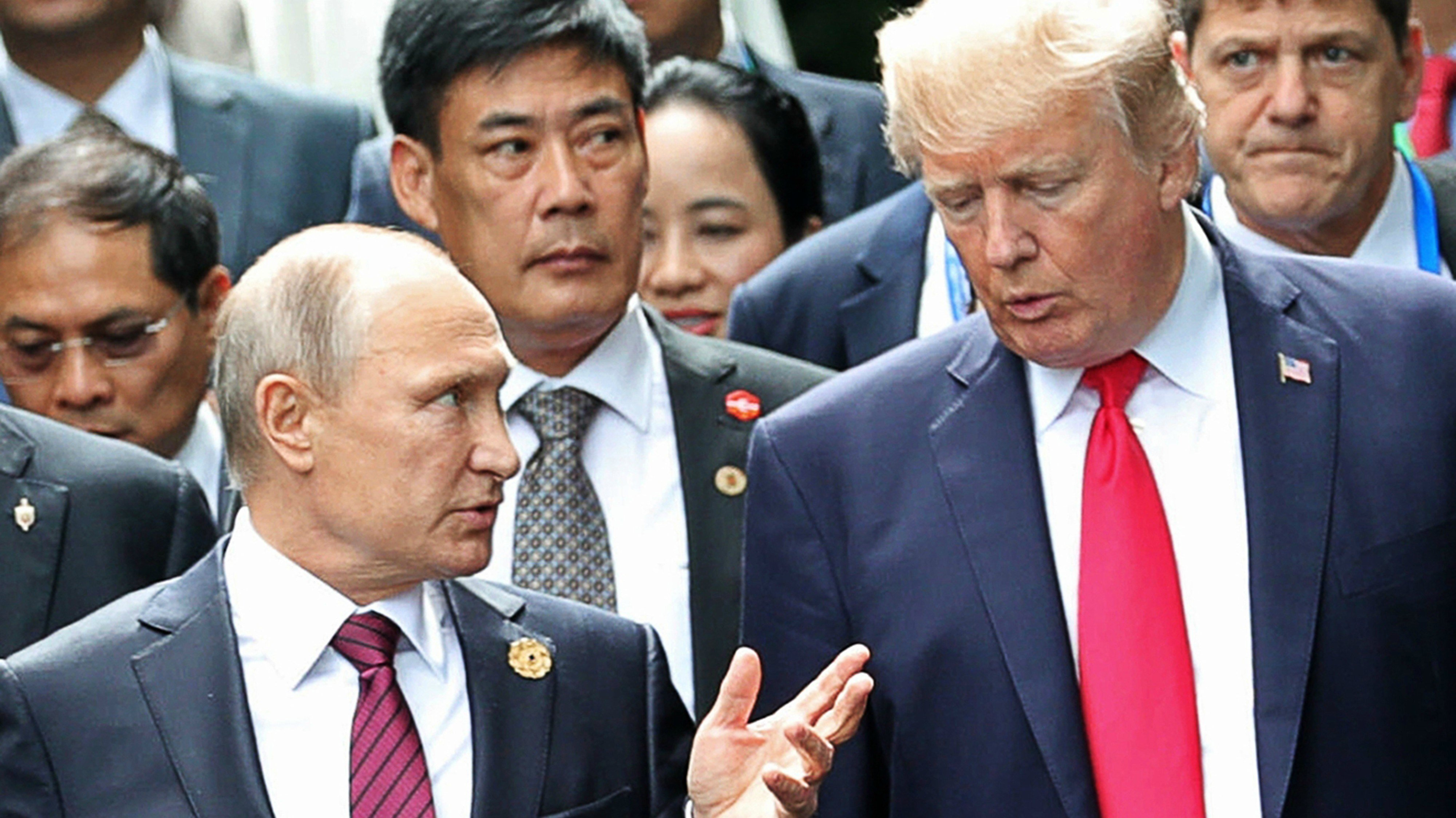 In this Nov. 11, 2017, file photo, President Donald Trump, right, and Russia President Vladimir Putin talk during the family photo session at the APEC Summit in Danang.  (Mikhail Klimentyev, Sputnik, Kremlin Pool Photo via AP)