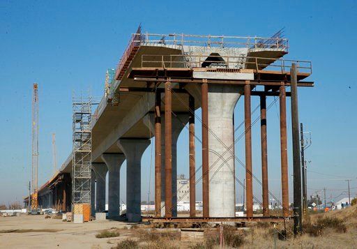FILE - This Dec. 6, 2017 file photo shows one of the elevated sections of the high-speed rail under construction in Fresno, Calif. High-speed rail executives are urging skeptical lawmakers to provide more long-term funding for the bullet train in the face