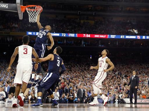 Villanova's Mikal Bridges (25) dunks during the second half of the NCAA Final Four tournament college basketball semifinal game against Oklahoma, Saturday, April 2, 2016, in Houston. (AP Photo/David J. Phillip)
