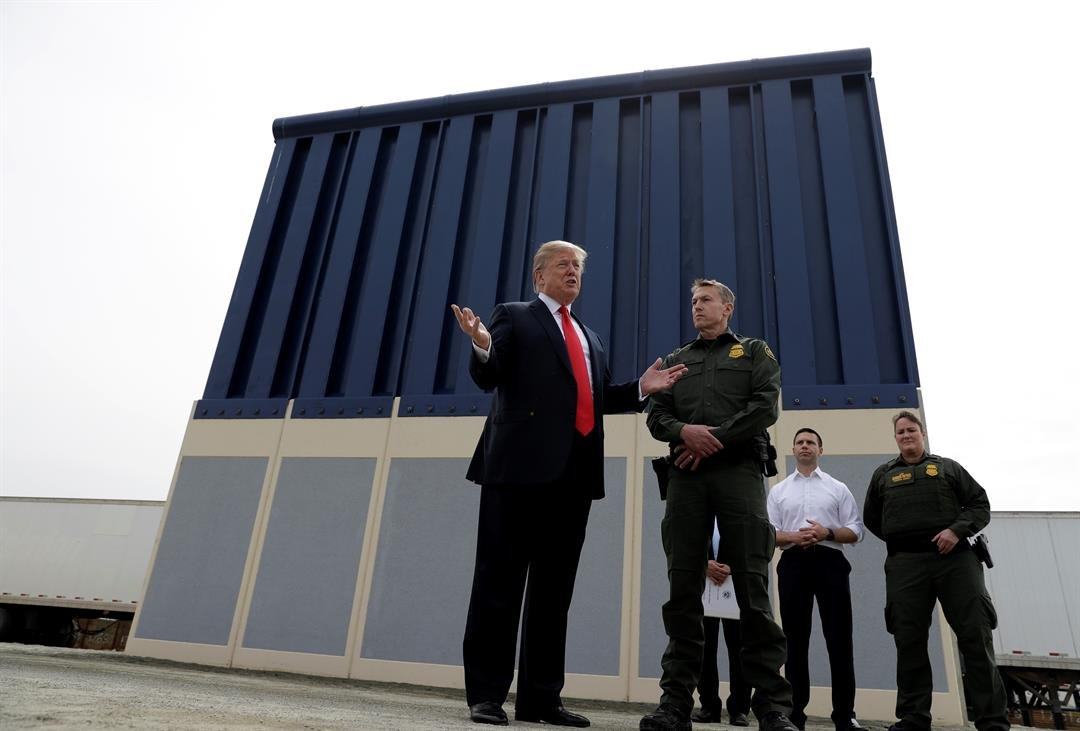 President Donald Trump reviews border wall prototypes, Tuesday, March 13, 2018, in San Diego.