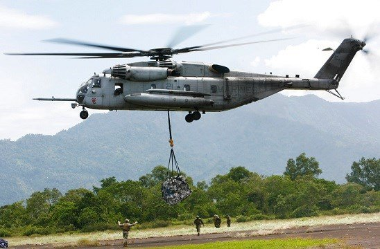 In this Saturday Oct. 10, 2009, file photo, a U.S. military helicopter, the CH-53E Super Stallion, airlifts humanitarian aid.